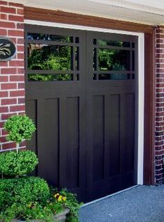 dark red brick house with black shutters black garage door - Google Search