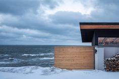 Omar Gandhi Architect perches glass-walled cabin on rocky cliff in Nova Scotia