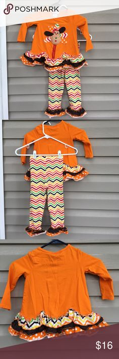 Bonnie Jean girls 2 piece Thanksgiving top, pants Very cute outfit, orange with turkey on front of ruffled bottom of long sleeve knit top. Multi colored leggings in zig zag pattern with ruffled cuffs. 95% cotton 5% spandex. No snags, stains or holes EUC Bonnie Jean Matching Sets