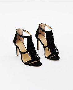 8a5c697ae9c Ann Taylor s strappy high heeled Tara Fringe Suede Sandals in black. Fringe  Sandals