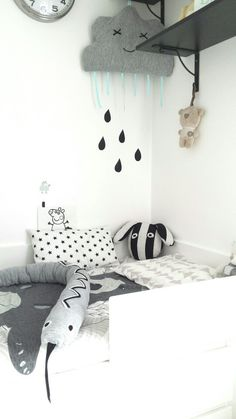 My sons black and white bedroom. Scandinavian style inspired. Snake, cloud, rain, rabbit, star cushion, peppa, white bed all hand made by myself and my husband. It took a while but we love the effect and our little one loves his new big bed too:)