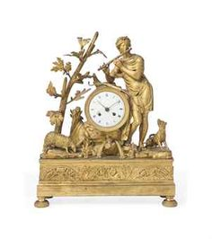 A FRENCH EMPIRE GILT-BRONZE MANTEL CLOCK  EARLY 19TH CENTURY