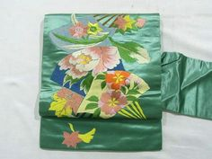 This is a vintage Nagoya obi with seasonal flower design such as 'Botan'(peony) and 'Sakura'(cherry blossom) on fan, which is embroidered vibrantly