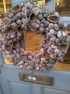 Love this! Great way to use poppy seed heads...must try it next year.