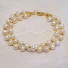 Check out this item in my Etsy shop https://www.etsy.com/listing/42938600/double-freshwater-pearl-bracelet-in-gold