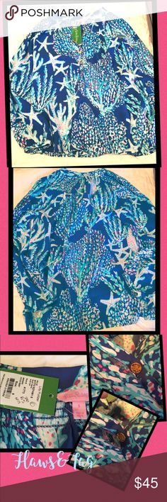 Lilly Pulitzer Elsa nwt - w/defect Lilly Pulitzer Elsa top. Beautiful print... It is new with tags and has a flaw as pictured above. There's a tear by the buttons. I assume a seamstress could fix this. Size small Lilly Pulitzer Tops Blouses
