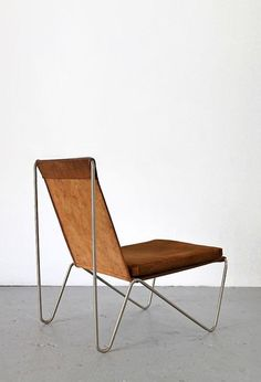 sold by Adore Modern. The Bachelor Chair in brown Leather by Verner Panton