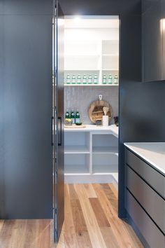 Choose the drama with a black kitchen – STYLE CURATOR Hidden walk-in pantry behind kitchen cabinetry. Clever way of integrating a pantry into a kitchen design. Modern and contemporary kitchen - Experience Of Pantrys Kitchen Pantry Design, Kitchen Cabinetry, Modern Kitchen Design, Rustic Kitchen, Kitchen Decor, Kitchen Pantries, Kitchen Shelves, Kitchen Ideas, Contemporary Kitchens