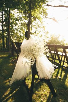 Tulle bow with babys breath wedding ceremony chair decor.  Someone recently suggested to me an all baby's breath wedding. Browsing ideas. Not sure! -Ashleigh