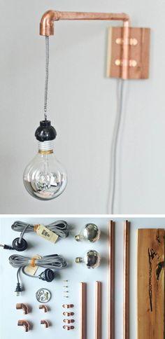 Lámpara de pared con tubos de cobre