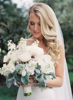 Sideswept wedding hair with a veil