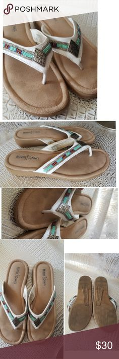 Minnetonka leather flip flop shoes beaded sandal A great pair of Minnetonka leather flip flop shoes with beaded and silver details on top of a white leather thong the sandals are perfect for jeans or a sundress and pretty enough to be worn with a low on the flowing maxi dress   Pre owned condition *******All items are in pre owned condition, Nothing, unless noted , is brand new **** please ask questions For sale in my posh closet  LINK IN MY BIO to see video clips of some of my pieces…