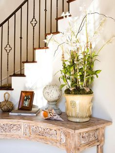 Wall in our foyer entryway console table, modern console tables, entryway d Iron Stair Railing, Wrought Iron Stairs, Curved Staircase, Staircase Design, Stair Spindles, Iron Balusters, Foyer Design, Railings, Entryway Console Table