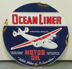 "Ocean Liner Motor Oil Porcelain Sign (Vintage 1940 Gas Station Display Sign, Antique Gasoline Advertising Signs, ""Paraffine Quality"", ""Pours Freely Below Zero"", ""Excellent in Hot Weather"", ""3000 Miles of Lubrication"")"