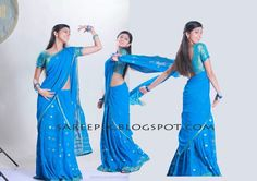 """Tamil actress Praneetha in blue half saree with blue transparent choli and blue designer blouse from her first telugu movie """"Bava""""."""