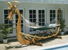 Viking-inspired hammock stand. Lots of details in the dragon. A little over the top, but cool nonetheless. I would opt to design my own minimalist stand though when it is time to build my own.