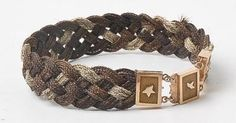 Mourning bracelet made with three colors of hair and a gold catch.