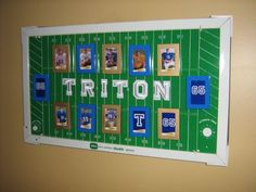 This is an old metal football game from the 60s. I added magnets to photo frames, added Alex's football photos and added letters from the sewing section to spell TRITON.