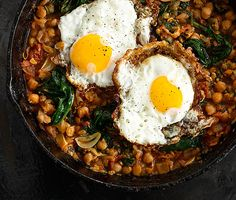 SPINACH WITH CHICKPEAS AND FRIED EGGS: From Bon App'etit test kitchen 2012.j ~ We love the frilly edges of olive oil-fried eggs. Serve them over thickpeas for a vegetarian main!         Spinach with Chickpeas and Fried Eggs Recipe  at Epicurious.com