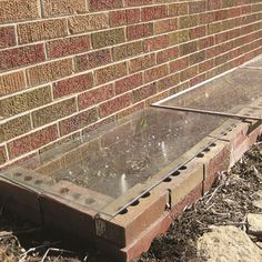 Salvaged storm windows and a few spare bricks are all you'll need to assemble this DIY cold frame that will work in almost any garden space.