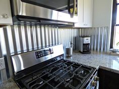 how to use corrugated tin as a backsplash in a kitchen | kitchens