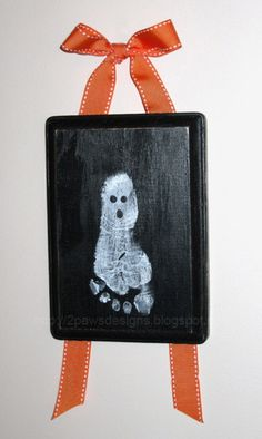 Use children's feet to make ghostly white footprints! Cute for door hangers around Halloween!