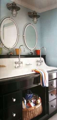 love the lighting and fun porthole mirrors (the sink reminds me of a school bathroom sink... I love it. No water on the counter after I wash my face)