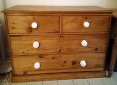 Pine Chest with porcelain knobs. For the knobs click below: http://www.priorsrec.co.uk/white-victorian-porcelain-cupboard-knob-/p-3-15-90-463