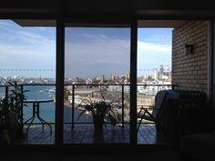 Secure Sliding Door Highlighting The Beautiful Sydney Harbour.