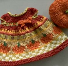 An Autumn Harvest Dress with pumpkins and a little blaze of color just under the waist much like the tiny batches of bright reds and yellows seen among the fading fall colors. Knitted Bunnies, Knitted Animals, Knitted Dolls, Crochet Dolls, Crochet Baby, Knit Crochet, Crochet Doll Clothes, Doll Clothes Patterns, Doll Patterns