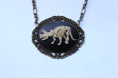Dinosaur Triceratops Skeleton Cameo Necklace - Antique Gold on Etsy, $24.00