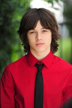 Leo howard i love his bright red shirt and the black tie to go with it