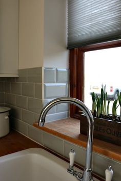 country kitchen, grey metro tiles from The Tile Mountain. grey blinds are the Duette blinds from Luxaflex