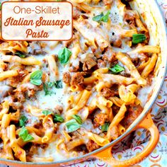 One-Skillet Italian Sausage Pasta--Hearty and very flavorful main course cooked all in one skillet!--Italian sausage, crimini mushrooms, marinara, Italian herbs, pasta, Parmesan and mozzarella.