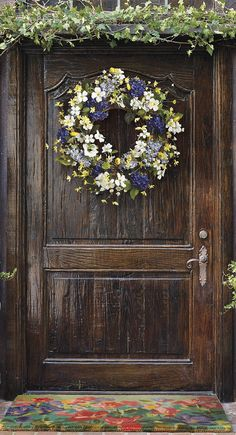 Sprigs of weeping forsythia, dogwood flowers and wild ranunculus convene in our Westerly Village Wreath.