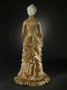 gold hued late Victorian gown from 1882 or 83.