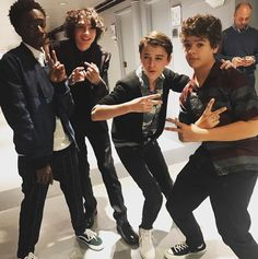 The guy in the back not even caring that he's next to the CAST OF STRANGER THINGS