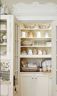 Cool white country kitchen pantry.