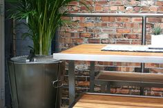 Sleek Stainless Steel And Natural Teak On The Balcony