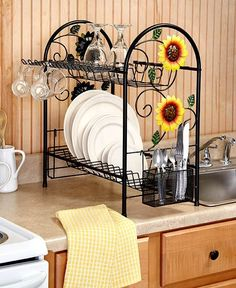Conserve counter space in your kitchen while drying dishes with this Deluxe 2 Tiered Dish Rack. It has a space-saving, 2-tier design with a foldout mug rack, a