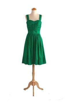 From an apw site. I kindof like the idea of this in a ivory/white (bridesmaid dress+white=cheap wedding dress...) but in green it's also a pretty deva-might-want-it.... ;)