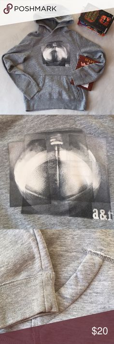 Abercrombie Kids Sweatshirt Abercrombie Kids - Grey sweatshirt. Cool football image of front. Gerald worn, great condition! Abercombie Kids Shirts & Tops Sweatshirts & Hoodies