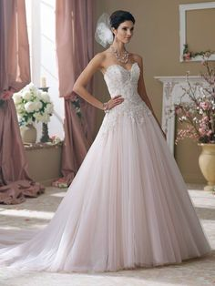 Was €2,200 Now €1,199. How romantic and dreamy is this blush pink wedding gown by David Tutera. We can just imagine the beautiful photos you could capture on your wedding day in this stunning dress. Size 16, can be easily altered to your size! www.timelessbridalwear.ie