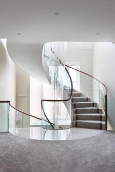 elegant spiral staircase, glass ballustrade