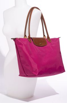 I really want the pink one to lug my wedding planning notebook in! Longchamp 'Le Pliage - Large' Tote available at #Nordstrom