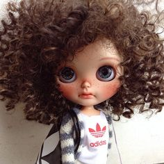 cool adidas shirt, knit vest, freckles and curls..