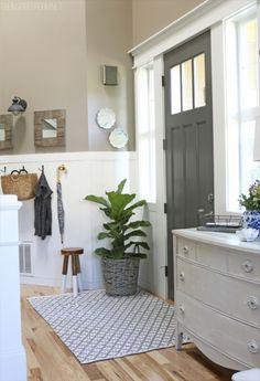 Door: Benjamin Moore Kendall charcoal, walls: Behr All-in-One studio taupe, trim: Benjamin Moore white dove