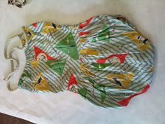 I love this swimsuit, I reckon it's 1950s judging by the fabric, cut and the fact that it's a one piece. I'm not if it is homemade or not, I suspect it probably is as I haven't photographed a label. I love the nautical print and the rope tie so kitsch!