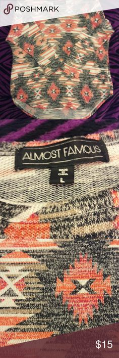 Almost Famous 3/4 sleeve top Light weight, super stretchy, cut high on sides and low on front/back. Super cute, great looking top. Almost Famous Tops