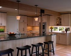 Light wood (natural maple) with black accents kitchen